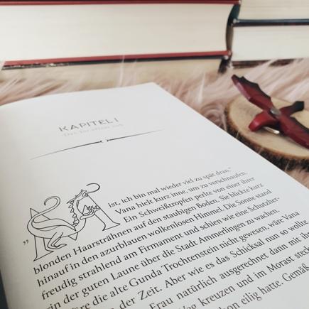 Kapitelanfang mit illustriertem ersten Buchstaben