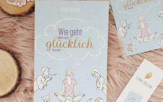 """Cover """"Wie geht denn nun glücklich"""" mit zugehörigem Lesezeichen"""